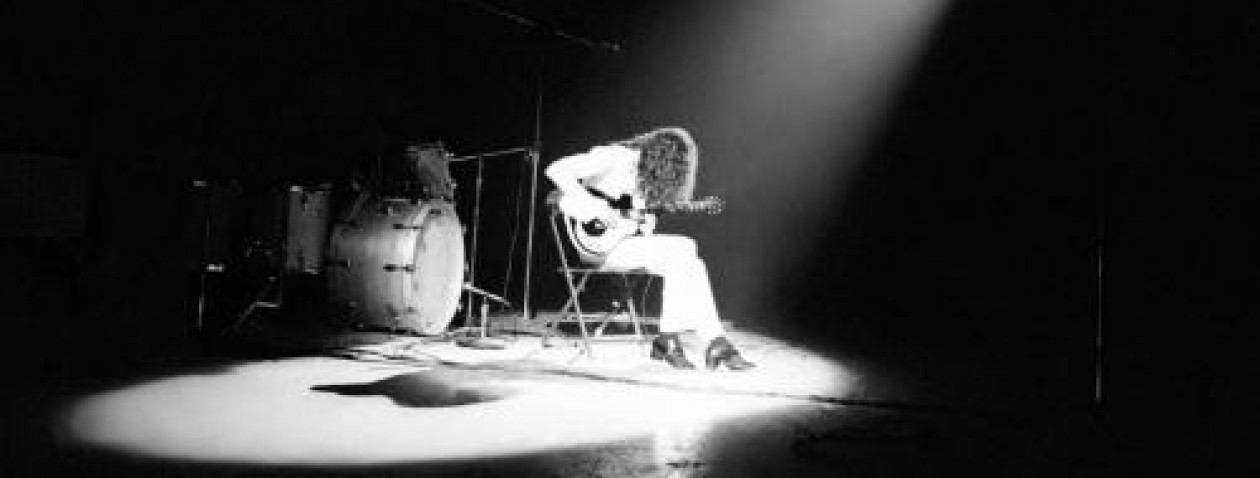 Jimmy Page, in the early years of Led Zeppelin, playing a Danelectro electric guitar.